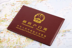 Household register of China. A household register of China on map background stock image