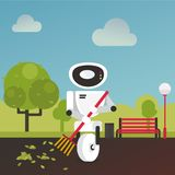 Domestic robot raking fall leaves in the garden with a broom in hand. Stock Photo