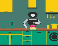 Household robot preparing cake at kitchen. Royalty Free Stock Photography