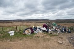 Rubbish dumped on moorland Royalty Free Stock Photo