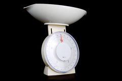 Household scales. Angle view of a kitchen scales on black background Stock Photos