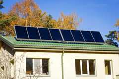 Household with solar panels on the roof Stock Images