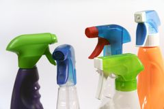 Household Spray Bottles. Five assorted, shapes, colors and sizes of utility, household spray bottles Stock Images