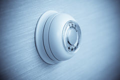 Household thermostat isloated on wallpaper Stock Images