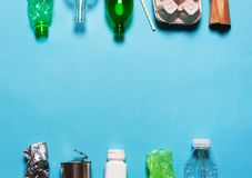 Household waste on a blue background. The concept of sorting plastic, polyethylene cardboard, paper, glass. Environment protection stock photos