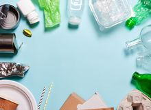 Household waste on a blue background. T. He concept of sorting plastic, polyethylene cardboard, paper, glass. Protection of the environment, ecology royalty free stock image