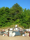 Household Waste Dump. A pile of discarded household objects at the dump royalty free stock image