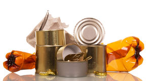Household waste: plastic bottles, tin cans, cardboard and cork isolated. Royalty Free Stock Photography