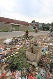 Household Waste Volume Rises. Scavengers looking for the remains of goods from a pile of garbage in Solo, Central Java, Indonesia. Each year, the volume of waste Stock Photos