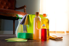 Household wood cleaners. Wood cleaners with bucket, gloves and sponge on living room hardwood floor stock image