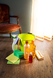Household wood cleaners. Wood cleaners with bucket, gloves and sponge on living room hardwood floor stock photography