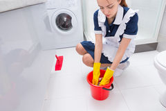 Housekeeper changing the cloth on the mop Stock Photos