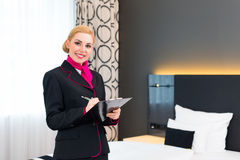 Housekeeper checking hotel room Royalty Free Stock Image