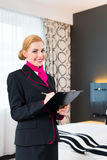Housekeeper checking hotel room Stock Photography