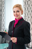 Housekeeper checking hotel suite Stock Photography
