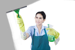 Housekeeper cleaning the glass with cleaner tools Stock Image