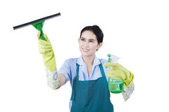 Housekeeper cleans with cleaning equipment Royalty Free Stock Image