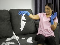 Housekeeper cleans the house and feels disgusting. Woman feeling disgust cleaning house.  royalty free stock photo
