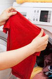 Housekeeper doing the laundry Royalty Free Stock Photography