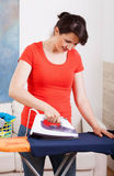 Housekeeper ironing shirt Stock Photography