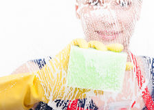 Housekeeper lady using sponge to make window clean Stock Image