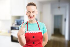 Housekeeper or maid showing number two with fingers. On clean indoors background Royalty Free Stock Images