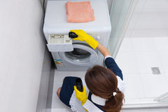 Housekeeper preparing washing machine for a load Royalty Free Stock Image
