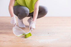Housekeeper sweeping wooden floor Royalty Free Stock Photography