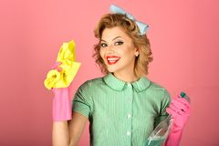 Housekeeper in uniform with clean spray, duster. royalty free stock photography