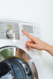 Housekeeper with washing machine Royalty Free Stock Images