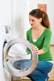 Housekeeper with washing machine Royalty Free Stock Photos