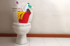 Housekeeping. Cleaning products in a bucket on a toilet royalty free stock photo
