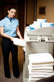 Housekeeping in charge pulling out the bath towel. From the cart to deliver it to rooms Royalty Free Stock Images
