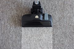 Housekeeping before and after concept - modern vacuum cleaner ov Royalty Free Stock Photos