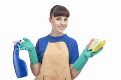 Housekeeping Concept: Young caucasian Housewife With Sponges and Royalty Free Stock Images