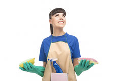 Housekeeping Concept: Young caucasian Housewife With Sponges and Royalty Free Stock Photo
