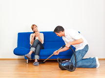 Housekeeping couple Stock Images