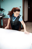 Housekeeping executive making the bed ready. Before customers arrive Royalty Free Stock Photo