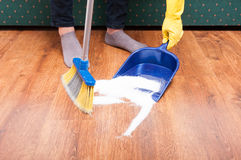 Housekeeping lady cleaning the mess from the floom stock photos