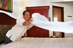 Housekeeping or room boy with big smille. Photograph of room boy hotel at work. copy link below in your browser address for complete series royalty free stock photography
