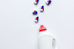 Housekeeping set with detergent plastic bottles in laundry top view stock images