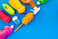 Housekeeping set. Detergents, soap, cleaners and brush for housecleaning on blue background top view mock-up.  royalty free stock photos