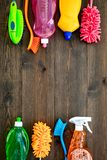 Housekeeping set. Detergents, soap, cleaners and brush for housecleaning on wooden background top view mock-up.  stock images