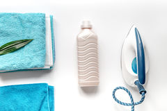 Housekeeping set with towels and iron on laundry background top view Stock Images