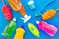 Housekeeping tool. Detergents, soap, cleaners and brush for housecleaner work on blue background top view space for text royalty free stock photos