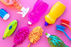Housekeeping tool. Detergents, soap, cleaners and brush for housecleaner work on pink background top view space for text stock photos