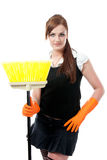 Housemaid with broom Stock Images