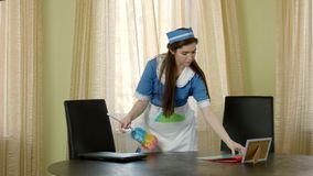 Housemaid with fluffy dust brush. stock footage