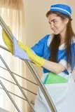 Housemaid in gloves working. Stock Photography
