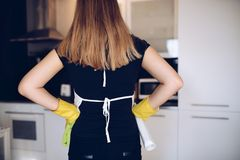 Housemaid in kitchen Royalty Free Stock Image